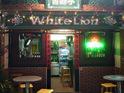白狮子酒吧的封面